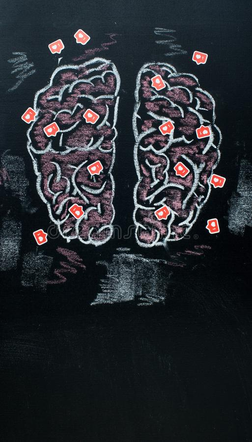Human brains full of likes symboles on black chalk board stock photos