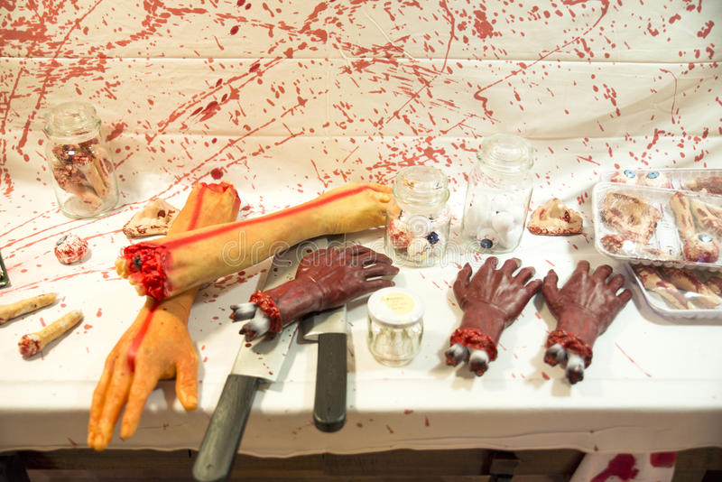 Human butchered on a table. The day of hallowen stock images