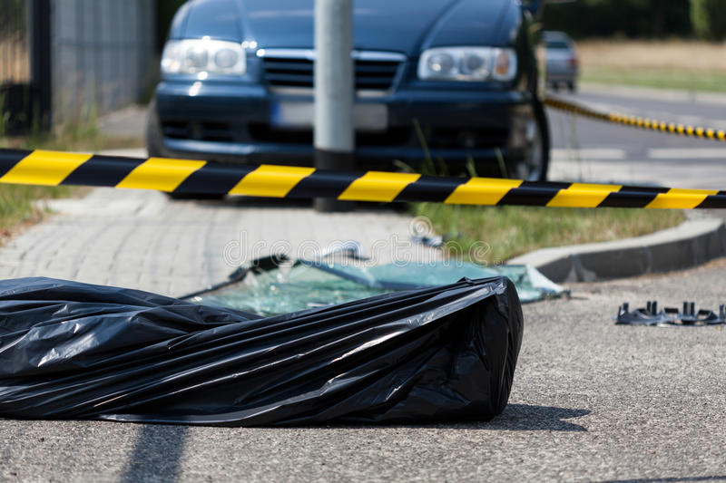 Human corpse on the accident area. Horizontal stock photo