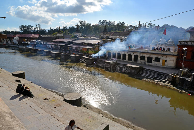 Human cremation along the holy Bagmati River at Pashupatinath, N. PASHUPATINATH - OCT 8: Human cremation along the holy Bagmati River at Pashupatinath, the stock images