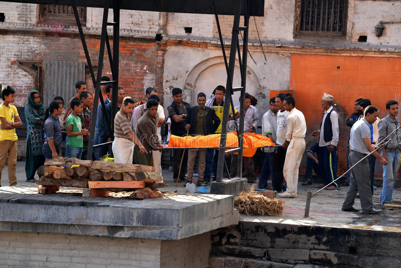 Human cremation ceremony in Pashupatinath, Nepal. PASHUPATINATH - OCT 8: Cremation ghats and ceremony along the holy Bagmati River at Pashupatinath Temple, on stock photos