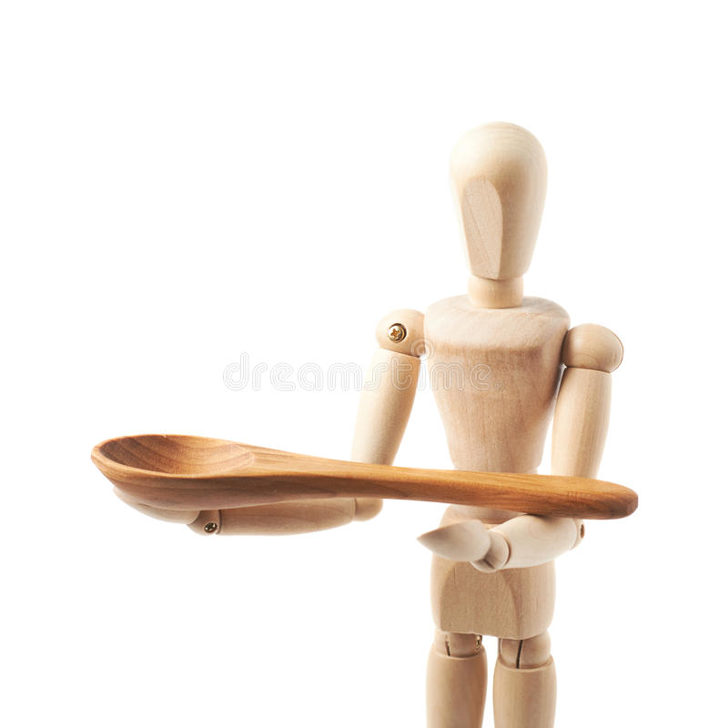 Human doll puppet statuette isolated. Made of wood human doll puppet statuette holding a serving wooden spoon, composition isolated over the white background stock photography