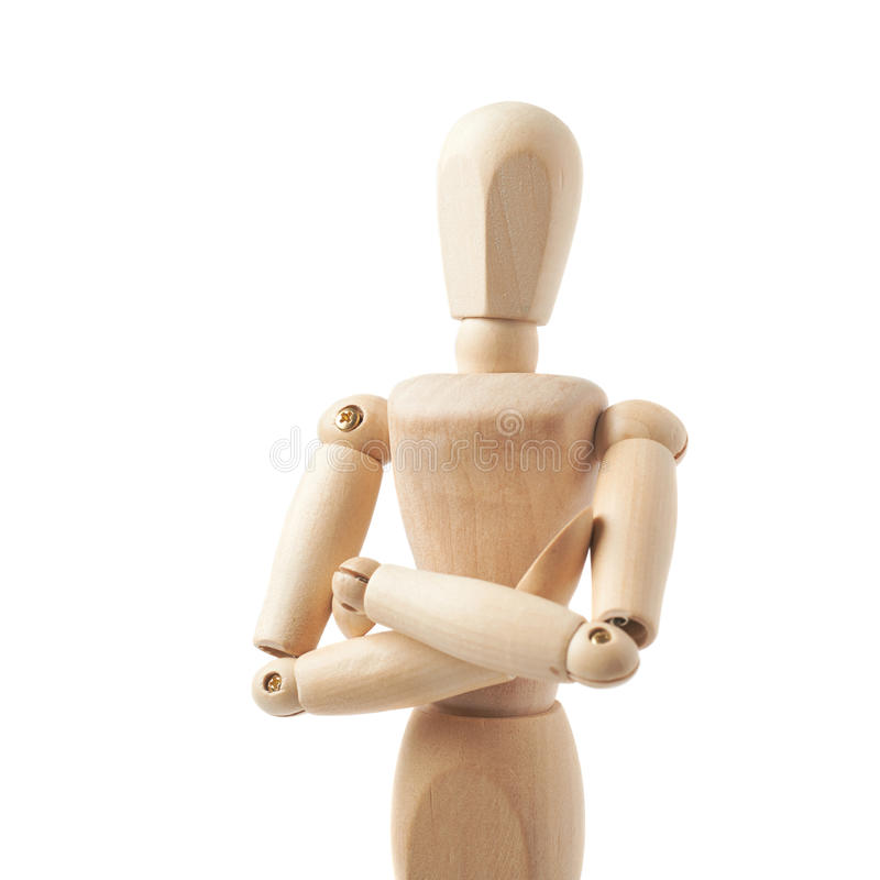 Human doll puppet statuette isolated. Made of wood human doll puppet statuette with its hands crossed, composition isolated over the white background stock photos
