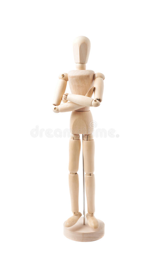 Human doll puppet statuette isolated. Made of wood human doll puppet statuette with its hands crossed, composition isolated over the white background royalty free stock images