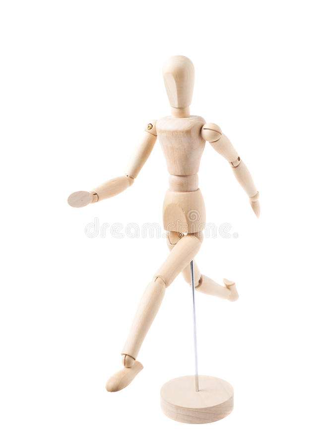 Human doll puppet statuette isolated. Made of wood human doll puppet statuette running, composition isolated over the white background royalty free stock photo