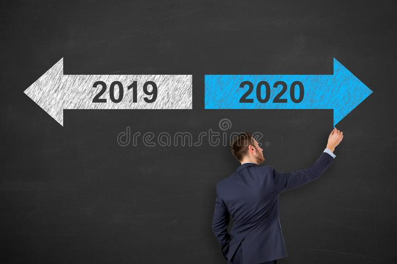 Human Drawing Old Year New Year 2020 on Blackboard Background royalty free stock images