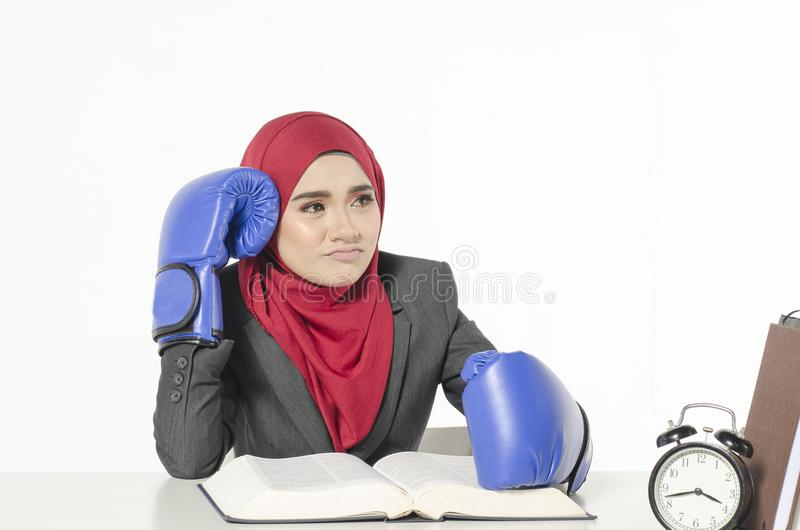 Human emotion expression feeling concept, stressed young business woman with boxing glove read a book royalty free stock photo