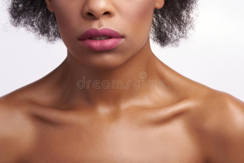 Sensual calm ethnic female on white background stock photo