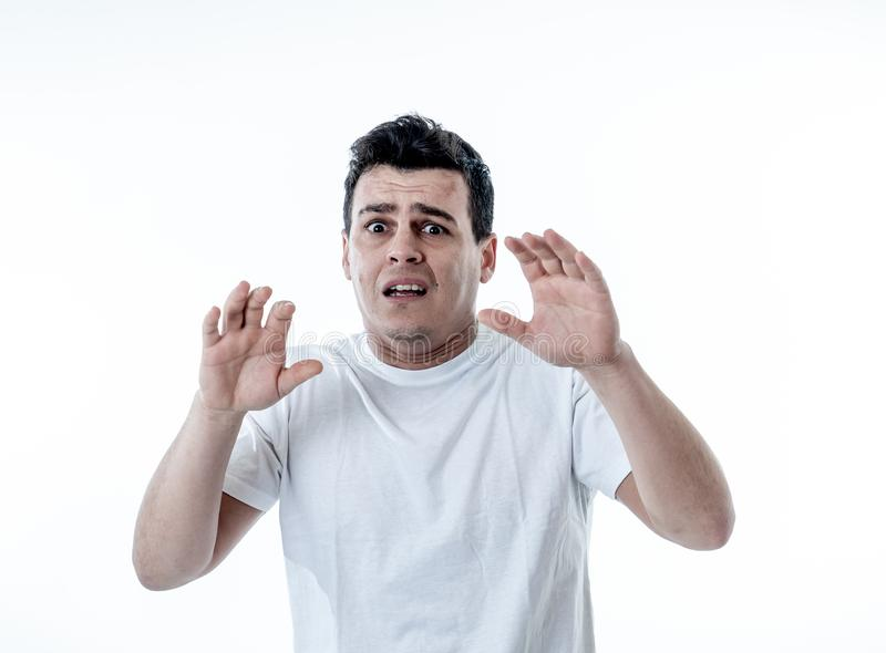 Human expressions and emotions. Concern scared shocked adult man with a terrified facial expression stock photography