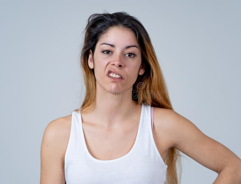 Human expressions and emotions. Desperate young attractive woman with angry face looking furious. Facial expressions, emotions Anger. Young attractive caucasian royalty free stock photos