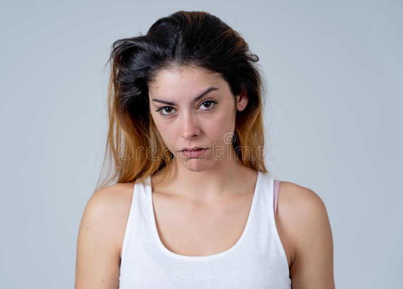 Human expressions and emotions. Desperate young attractive woman with angry face looking furious. Facial expressions, emotions Anger. Young attractive caucasian royalty free stock photo