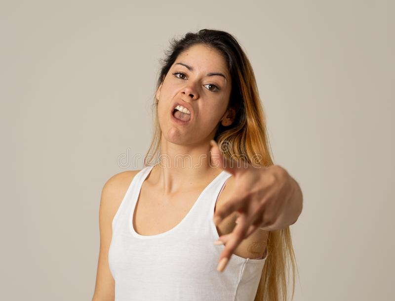 Human expressions and emotions. Desperate young attractive woman with angry face looking furious. Facial expressions, emotions Anger. Young attractive caucasian royalty free stock image