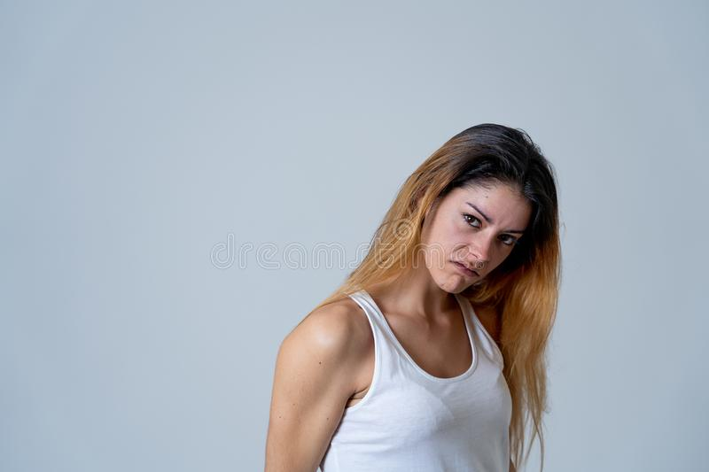 Human expressions and emotions. Desperate young attractive woman with angry face looking furious. Facial expressions, emotions Anger. Young attractive caucasian stock photography