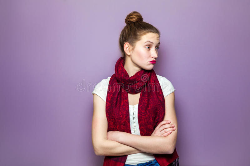 Human expressions emotions feelings body language. Thinking girl. Portrait closeup funny confused skeptical woman girl female thinking trying to recall looking stock photography