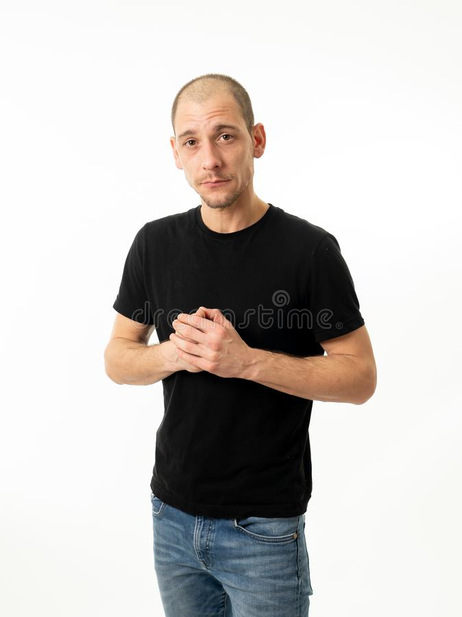 Human expressions and emotions. Young attractive man with a confident and neutral face. Half length portrait of handsome caucasian man with a neutral and royalty free stock photos