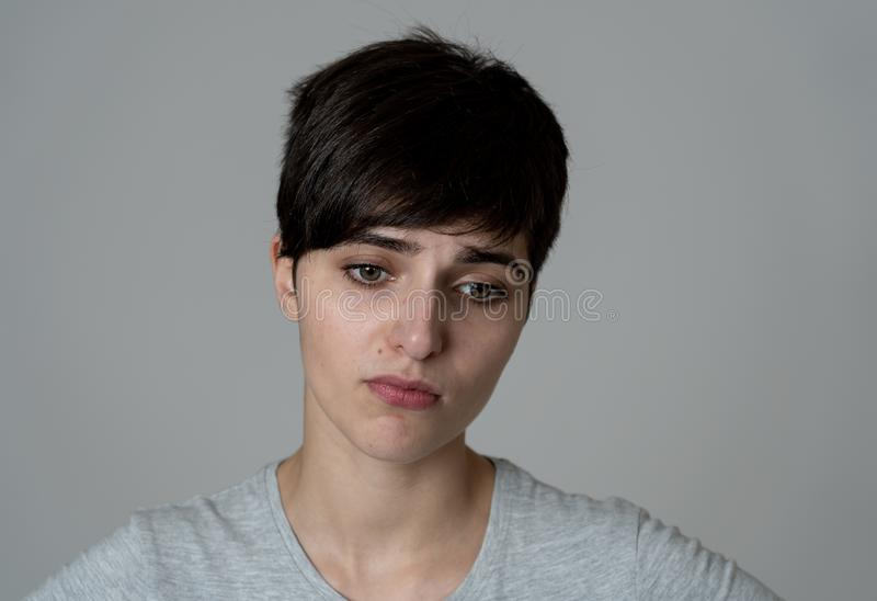 Human expressions and emotions. Young attractive woman sad and depressed looking down stock photography