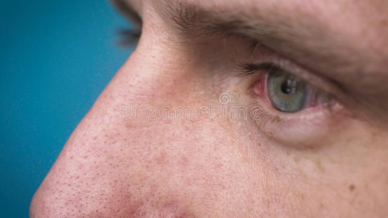 The human eye is depicted very closely with the brown hazel color of the movement of the eye and blink. Concept of: Hazel, Close. To the eye, Man, Woman stock photo