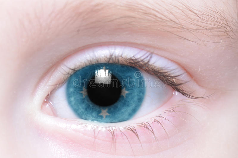 Human eye with national flag of federated states of micronesia royalty free stock image