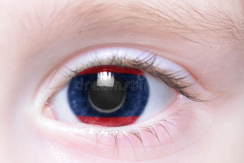 Human eye with national flag of laos stock photography