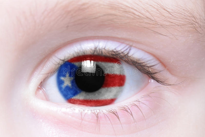 Human eye with national flag of puerto rico stock image