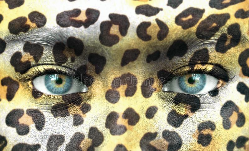Human face with animal patterns - Save endangered species concept stock photo