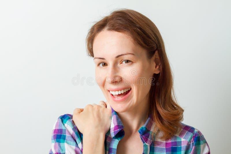 Close-up of beautiful happy woman looking at camera royalty free stock photos
