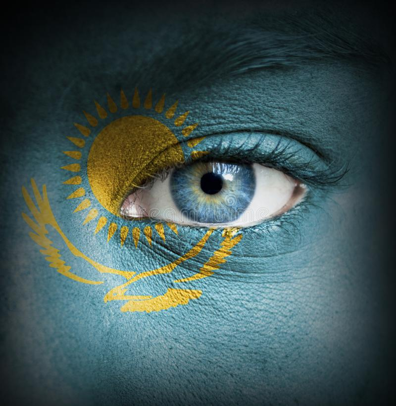 Human face painted with flag of Kazakhstan stock images