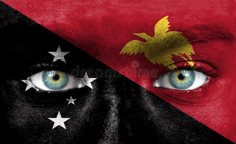 Human face painted with flag of Papua New Guinea stock image