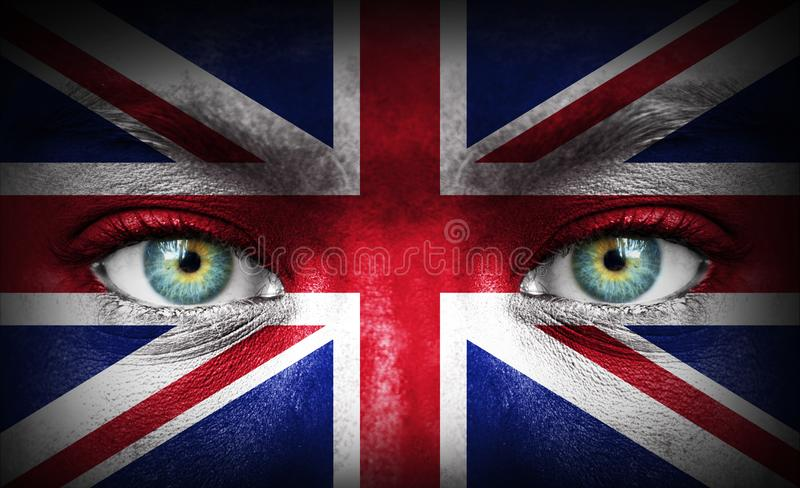 Human face painted with flag of United Kingdom stock image