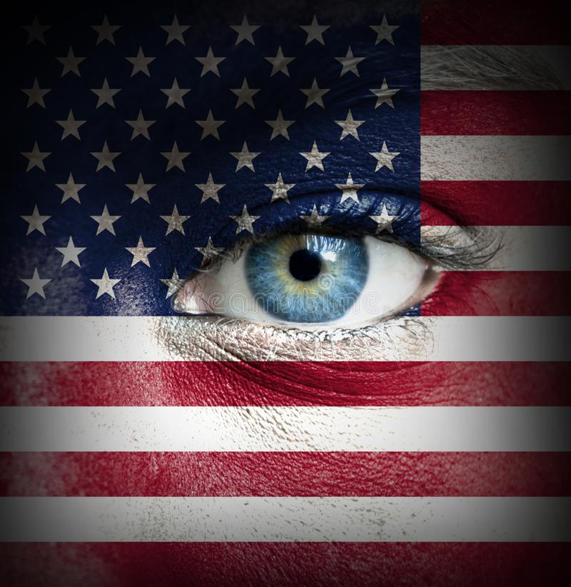 Human face painted with flag of United States of America royalty free stock images