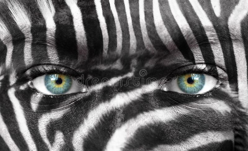 Human face with Zebra pattern - Save endangered species concept stock image