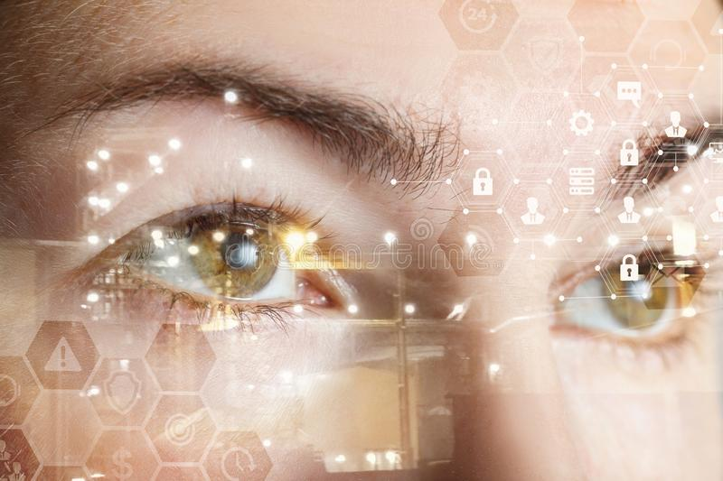 Human female eyes behind a comb cyber security system. A closeup of a human female eyes with comb cyber security system structure. The concept of data and stock image