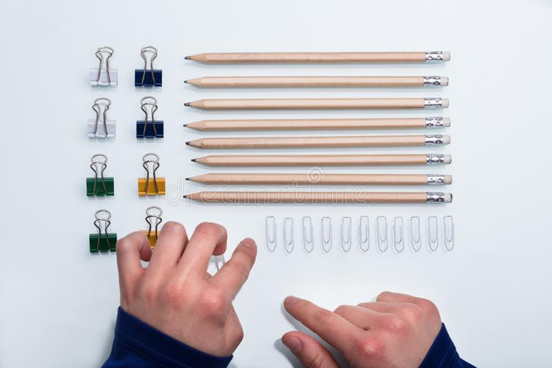 Human Hand Arranging Office Supplies royalty free stock photography