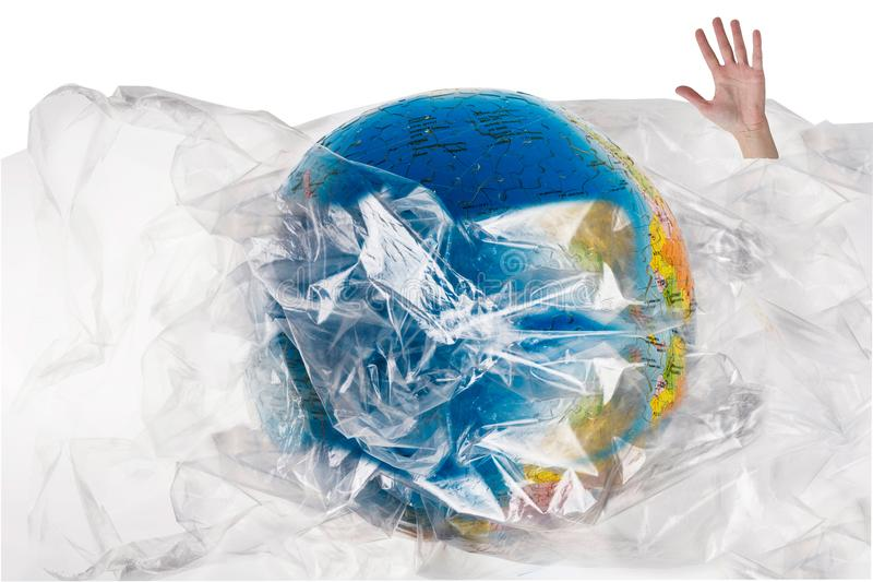 Human hand comes out of the plastic near the globe , human sinks in the plastic, our irresponsible, excessive consumption of plast. Ic, social advertising, world stock photos