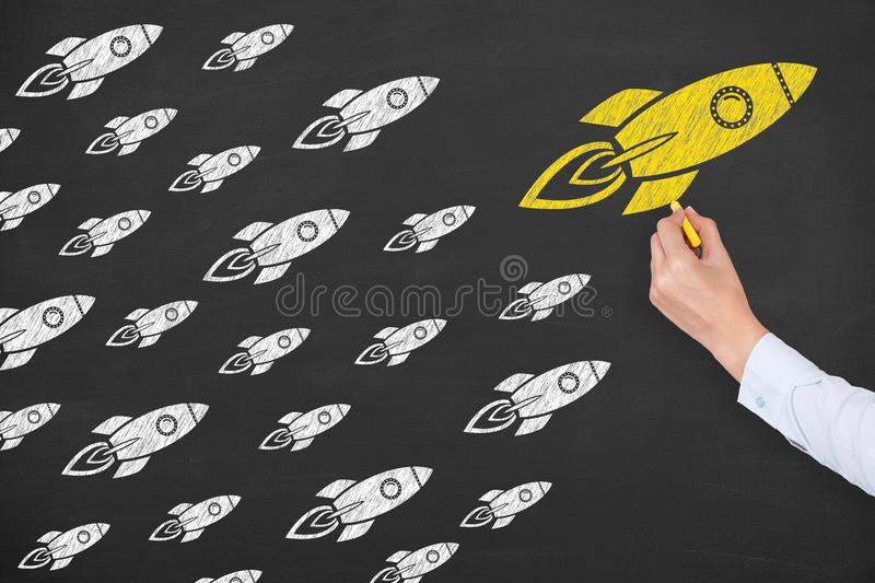 Human Hand Drawing Leadership Concepts on Chalkboard Background royalty free stock photo