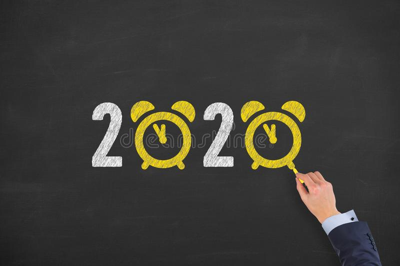 Human hand drawing new year concepts 2020 countdown clock on chalkboard background royalty free stock photos