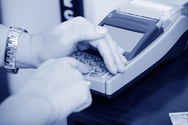 Human hand enter atm banking stock photo
