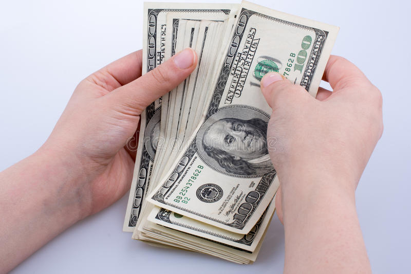 Human hand holding American dollar banknotes on white background. Human hand holding American dollar bill as money isolated on white royalty free stock image