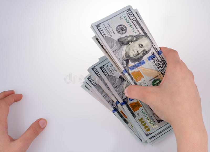 Human hand holding American dollar banknotes on white background. Human hand holding American dollar bill as money isolated on white royalty free stock photo