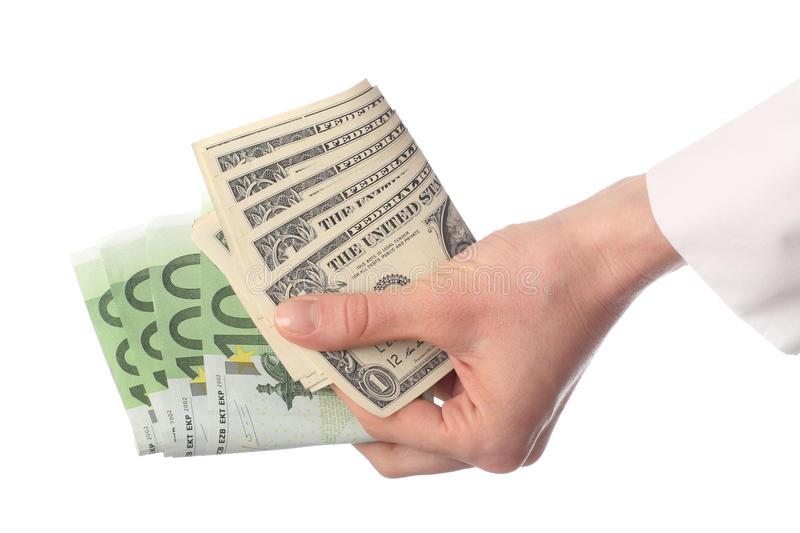 Human hand holding banknotes (euro and dollar). Isolated on white stock photos