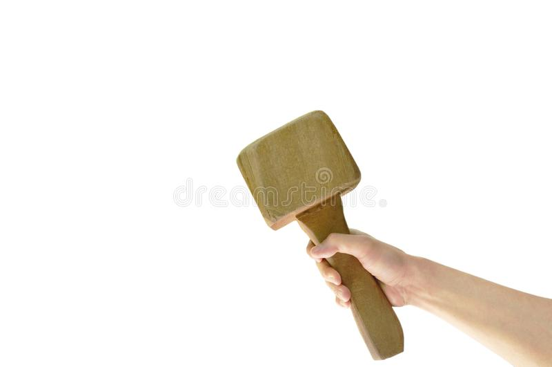 Human hand holding big wooden hammer on white background royalty free stock image