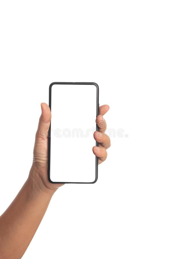 Human hand holding a black smartphone isolated on a white background. Females take a mobile with empty a monitor use for something, digital, technology stock photo