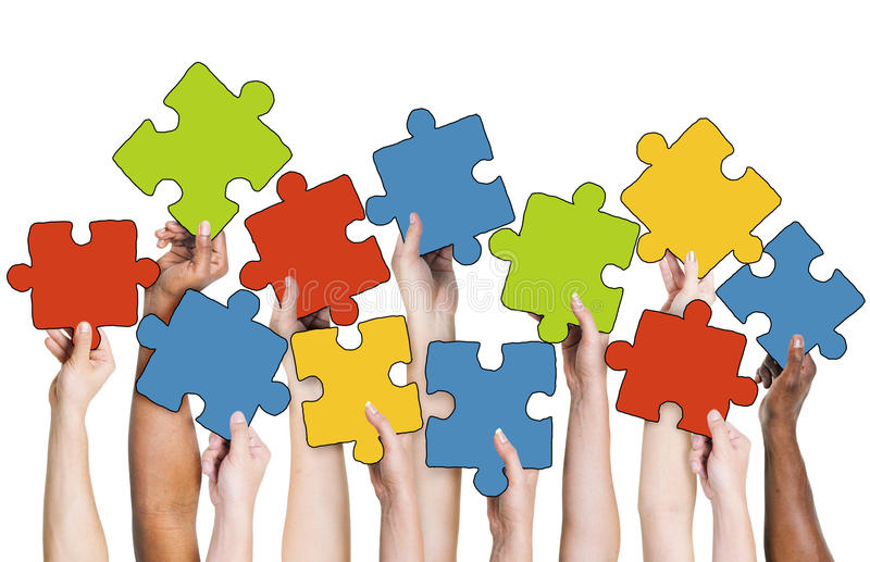 Download Human Hand Holding Colourful Jigsaw Puzzle Pieces Stock Image