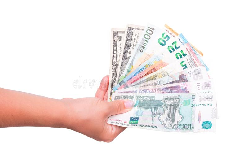 Human hand holding euro, dollar, and ruble money. Isolated on white background. Hand giving international banknotes royalty free stock photo