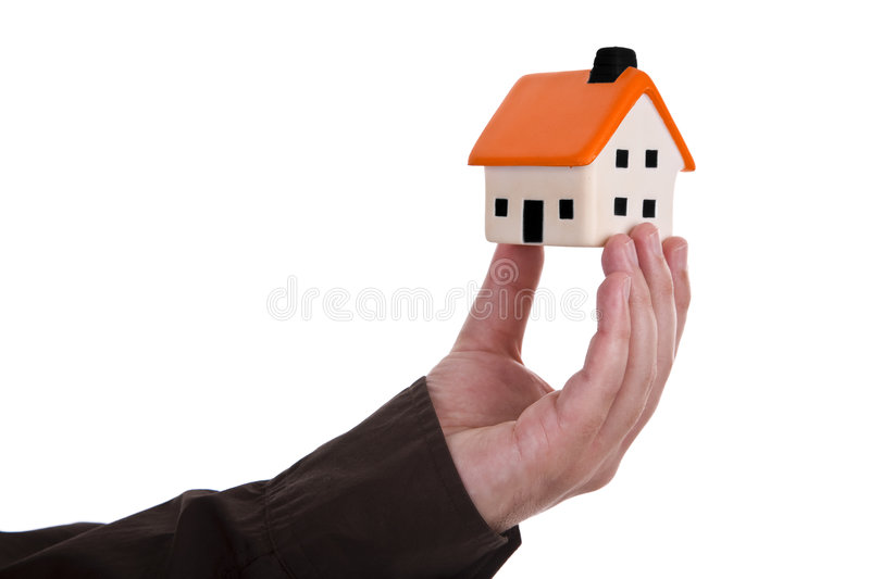 Human hand holding house. Human hand holding a small house stock image