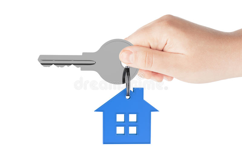 Human hand holding house key royalty free stock photos