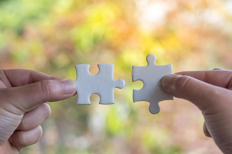 Human Hand Holding Jigsaw Puzzle Business Connection. Business Concepts royalty free stock image