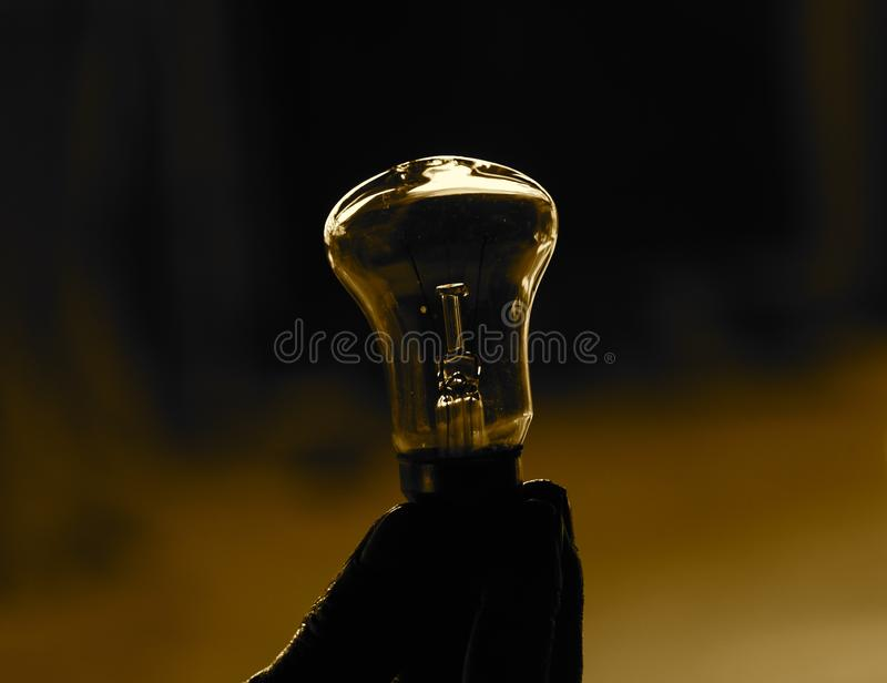 Human Hand Holding a Incandescent light bulb Background Photograph royalty free stock photos