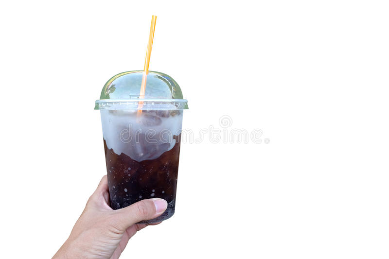 Human hand holding soda beverage in the plastic cup with yellow. Strew isolated with white background stock images