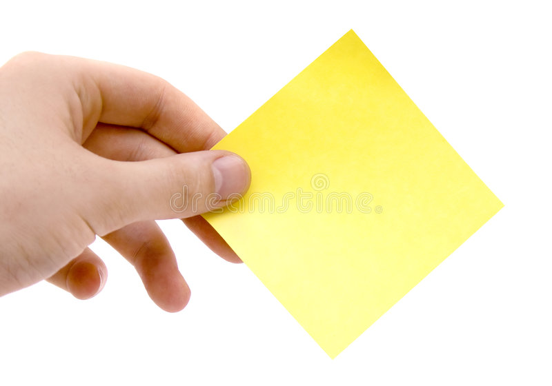 Human hand holding sticker